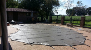Mikes Pool and Spa Service Installs Inground Pool Winter safety Covers.